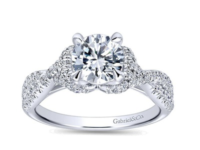 Cropped product listing twisting engagement ring